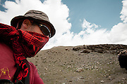 Photographer Matthieu Paley, near the shrines of Bozoi Gumbaz. Between Langar and Bozoi Gumbaz, the entrance to the Little Pamir Plateau...Trekking up and along the Wakhan river, the only way to reach the high altitude Little Pamir plateau, home of the Afghan Kyrgyz community.