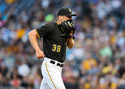 Jun 15, 2018; Pittsburgh, PA, USA; Pittsburgh Pirates starting pitcher Chad Kuhl (39) reacts during the fourth inning against the Cincinnati Reds at PNC Park. Mandatory Credit: Ben Queen-USA TODAY Sports