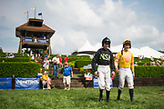 April 29, 2017, 22nd annual Queen's Cup Steeplechase. Jockeys Sean McDermott and Rhys Flint walk to the parade ring.