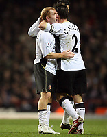 Photo: Rich Eaton.<br /> <br /> Aston Villa v Manchester United. The Barclays Premiership. 23/12/2006. Paul Scholes left is congratulated by Gary Neville after his second  half goal