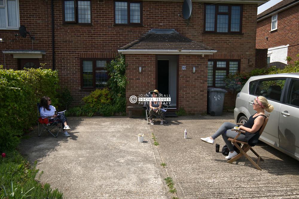Safe distance 50th birthday party in driveway during Coronavirus lockdown, UK 2020. MR