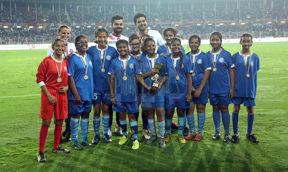 Akshay Tandon President of FC Goa, Virat Kohli, Indian cricket captain and co-owner FC Goa  and Jill Ferguson Managing director of FC Goa(R TO L) with winners of U12 girls league during match 85 of the Hero Indian Super League between FC Goa and ATK  held at the Jawaharlal Nehru Stadium, Goa, India on the 28th February 2018<br /> <br /> Photo by: Sandeep Shetty  / ISL / SPORTZPICS