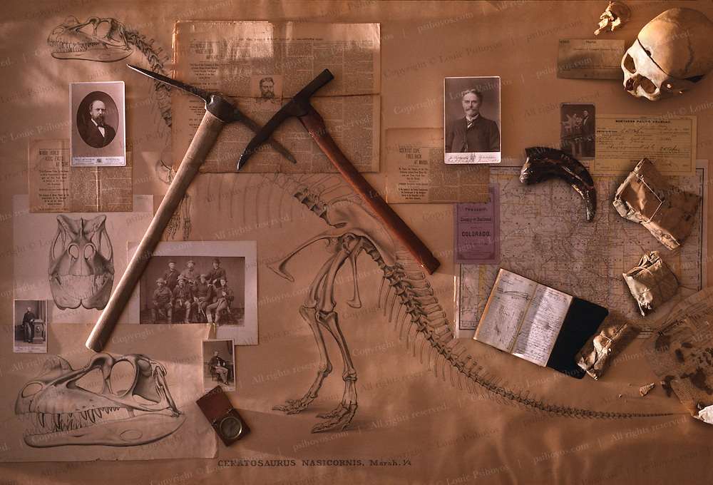 Artifacts from the lives of archenemies O.C. Marsh (left) and Edward Drinker Cope.  From Yale University, the Marsh pick became the standard for today's paleontologists.  Marsh's commissioned drawings of a Ceratosaurus, from the archives of the Smithsonian Institution, provide a backdrop for his compass and portrait of him (center row middle) and his 1870 field crew to the West.  Cope artifacts include: his pick and field diary from the American Museum of Natural History; from the Smithsonian archives, headlines of the original New York Herald chronicling their public fued; field specimens discovered in the vaults of the Philadelphia Academy of Natural Sciences, left as Cope had prepared them for shipment - still wrapped in newspapsers of the day, the Fargo Forum and the Sioux County Herald, both dated 1893.  From the University of Pennsylvania, the bones of the legendary bone hunter himself, Professor Edward Drinker Cope.