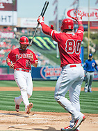 Geovany Soto scores as Gregorio Petit waits at home during the Angels' preseason game against the Chicago Cubs at Angel Stadium Sunday.<br /> <br /> <br /> ///ADDITIONAL INFO:   <br /> <br /> angels.0404.kjs  ---  Photo by KEVIN SULLIVAN / Orange County Register  --  4/3/16<br /> <br /> The Los Angeles Angels take on the Chicago Cubs at Angel Stadium during a preseason game at Angel Stadium Sunday.<br /> <br /> <br />  4/3/16