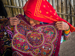 Central America, Panama Guna Yala (also known as San Blas Islands),  woman with embroidered mole cloth