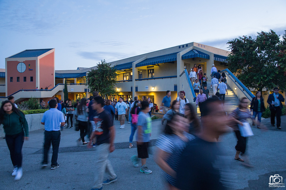 Parents walk outside the L Building during Back To School Night at Milpitas High School in Milpitas, California, on August 30, 2016. (Stan Olszewski/SOSKIphoto)