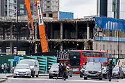 Londoners and the changing urban landscape of the former Elephant & Castle shopping centre which is being demolished and redeveloped in south London, on 22nd June 2021, in London, England. The much-criticised architecture of the Elephant & Castle Shopping Centre was opened in 1965, built on the bomb damaged site of the former Elephant & Castle Estate, originally constructed in 1898. The centre was home to restaurants, clothing retailers, fast food businesses and clubs where south Londoners socialised and met lifelong partners.