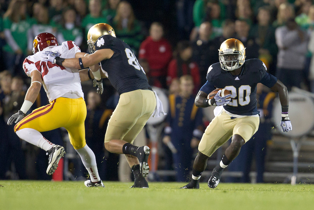 Notre Dame running back Cierre Wood (#20) runs for yardage during first quarter of NCAA football game between Notre Dame and USC.  The USC Trojans defeated the Notre Dame Fighting Irish 31-17 in game at Notre Dame Stadium in South Bend, Indiana.