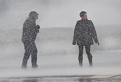 © Licensed to London News Pictures. 08/02/2019. Southsea, UK. A couple get a soaking as the wind brings  waves crashing across the sea front at Southsea, near Portsmouth. Storm Erik is hitting southern parts of the UK. Photo credit: Peter Macdiarmid/LNP