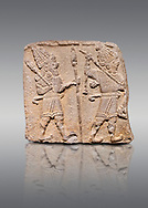 Aslantepe Hittite relief sculpted orthostat stone panel. Limestone, Aslantepe, Malatya, 1200-700 B.C. Anatolian Civilisations Museum, Ankara, Turkey. Scene of two Gods walking one carrying a spear, dressed in tunics.<br /> <br /> Against a gray background. .<br /> <br /> If you prefer to buy from our ALAMY STOCK LIBRARY page at https://www.alamy.com/portfolio/paul-williams-funkystock/hittite-art-antiquities.html . Type - Aslantepe - in LOWER SEARCH WITHIN GALLERY box. Refine search by adding background colour, place, museum etc.<br /> <br /> Visit our HITTITE PHOTO COLLECTIONS for more photos to download or buy as wall art prints https://funkystock.photoshelter.com/gallery-collection/The-Hittites-Art-Artefacts-Antiquities-Historic-Sites-Pictures-Images-of/C0000NUBSMhSc3Oo