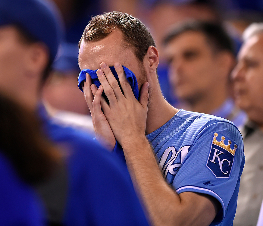 A fan reacted after Oakland Athletics' Brandon Moss hit a three-run home run during the sixth inning against the Kansas City Royals during the American League Wild Card baseball game on September 30, 2014 at Kauffman Stadium in Kansas City, MO.