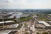 Nederland, Amsterdam, Westpoort, 25-05-2010. Aanleg Westrandweg ter hoogte van Noordzeeweg/Basisweg. De nieuwe weg zal aansluiten op Tweede Coentunnel. In de achtergrond Hornhaven en andere havens (Westhaven).Construction Westrandweg, the new road will connect to the new Coen tunnel. Port in the background..luchtfoto (toeslag), aerial photo (additional fee required).foto/photo Siebe Swart