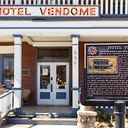 Hotel Vendome, located in downtown Prescott, a half a block away from Courthouse Square, still retains much of its original charm. Built in 1917, the hotel was originally built to help with a demand for housing in Prescott. Today the boutique hotel has 20 rooms and features an upstairs veranda, downstairs porch and clawfoot bathtubs is some of the rooms. The hotel is also rumored to have a ghostly occupant in room 16.<br /> <br /> Photograph by Jill Richards Hotel Vendome, Prescott, AZ