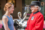 The first female Chelsea Pensioner meets Ksenia Ovsyanick of the English National Ballet on the Simon Gudgeon Stand - The opening day of th Chelsea Flower Show.