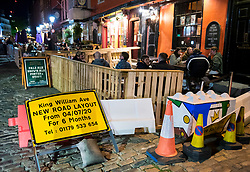 "© Licensed to London News Pictures; 25/09/2020; Bristol, UK. King Street in the city centre is much quieter than usual on the first weekend of the 10pm early closing curfew for pubs, bars and restaurants across the UK, imposed by the government to try and halt a second wave of the covid-19 coronavirus pandemic. Gathering in groups of more than six people is also banned and there are penalties of £200 on the first offence. From Monday 14 September it was illegal to meet up socially in groups of more than six people, known as the ""Rule of Six"", in order to try and contain the spread of the covid-19 coronavirus pandemic. Photo credit: Simon Chapman/LNP."