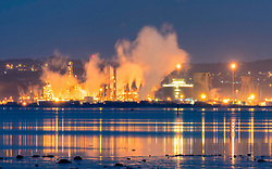 Grangemouth, Scotland, United Kingdom. 12 December, 2017. Night view of Grangemouth refinery in Scotland operated by INEOS. The global price of Brent crude increased today because of repairs to the Forties oil pipeline being carried out by INEOS. The pipeline supplies oil to the refinery.