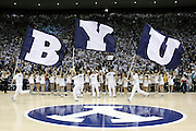 BYU cheerleaders carry flags as they enter Marriott Center before their team's NCAA basketball game against St. Mary's in Provo, Utah, Saturday, Jan. 28, 2012. (AP Photo/Colin E Braley)