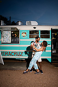 Katie Marks and Will Juste dance in front of the Veracruz taco bus at Noche de Cumbia, a regular event held at the East Austin Veracruz.