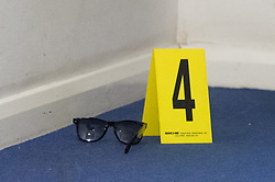 © Licensed to London News Pictures. 12/03/2020. London, UK. An evidence identification marker sits next to a pair of glasses at a crime scene after police were called to reports of a group of youths fighting at Mansion Court in Walthamstow, four teenagers were taken to hospital with stab and slash injuries. Seven arrests were made. Photo credit: Peter Manning/LNP