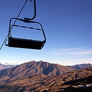 Global Warming...Climate Change. NZ Ski cancel season start after the hottest May on record...The chair lifts at Coronet Peak, Queenstown, New Zealand, lie dormant with little snow on the hillside after snow making was stopped due to the warm weather. NZ Ski issued a statement yesterday announcing the delayed start of the ski season which, was due to commence this weekend..New Zealand sweltered through its hottest May since record-keeping began with figures issued today (June 1st)  by climate agency Niwa showed that May was 2.3C warmer than usual. The average monthly temperature was 13.1C, a heat normally expected for April. The previous hottest May, recorded in 2007, had a mean temperature of 12.4C. Coronet Peak, Queenstown, New Zealand. 1st July 2011. Photo Tim Clayton
