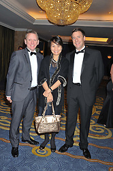 Left to right, SIMON COMINS, JOEY WAT and GOODWIN CHESTER at the 20th CEW (UK) Achiever Awards 2012 - celebrating two decades of women, passion, beauty, held at the Hilton, park Lane, London on 16th October 2012.