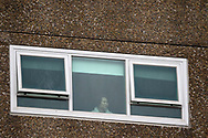 Angry residents are seen in the windows of the housing commission tower located at 12 Sutton Street amid a full and total lockdown of 9 housing commission high rise towers in North Melbourne and Flemington during COVID-19 on 5 July, 2020 in Melbourne, Australia. After 108 new cases where uncovered overnight, the Premier Daniel Andrews announced on July 4 that effective at midnight last night, two more suburbs have been added to the suburb by suburb lockdown being Flemington and North Melbourne. Further to that, nine high rise public housing buildings in these suburbs have been placed under hard lockdown for a minimum of five days, effective immediately.  Residents in these towers will not be allowed to leave their units for any reason. Police will be stationed at every entry and exit point, every level, and they will also surround these locations preventing any movement in, or out. There is a total of 1354 units and over 3000 residents living in these buildings including the states most vulnerable people. These new restrictions will remain in place for fourteen days with fears of further lockdowns to come. The Government have stressed that if Victorians do not follow the basic COVIDSafe rules, the whole state will go back in to lockdown. (Image by Dave Hewison/ Speed Media)