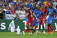 Portugal Midfielder Adrien Silva takes on France Midfielder Paul Pogba during the Euro 2016 final between Portugal and France at Stade de France, Saint-Denis, Paris, France on 10 July 2016. Photo by Phil Duncan.