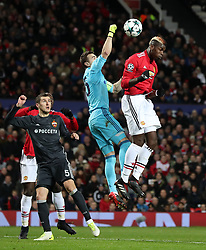 CSKA Moscow goalkeeper Igor Akinfeev punches the ball clear from Manchester United's Paul Pogba during the UEFA Champions League match at Old Trafford, Manchester.