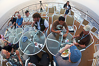 Nikonians Eating Dinner on Deck 6 of the M/V Explorer. UTW-II  2011 Spring Enrichment Voyage. Image taken with a Nikon D3s and 16 mm fisheye lens (ISO 400, 16 mm, f/5.6, 1/125 sec). Raw image processed with Capture One Pro, sharpened with Focus Magic, converted to sRGB/jpg with Photoshop CS5.