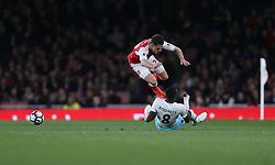 05 April 2017 London : Premier League Football; Arsenal v West Ham United :<br /> Granit Xhaka of Arsenal misses the ball and lands on Cheikhou Kouyate of West Ham.<br /> Photo: Mark Leech