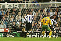 Photo. Glyn Thomas. <br /> Newcastle United v Norwich City. Barclays Premiership.<br /> 25/08/2004.<br /> Newcastle's Shay Given (L) is beaten by Norwich's Craig Fleming (#5) to put his side level at 2-2