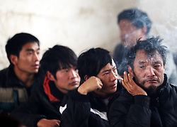 Relatives of victims listen an accident report in Zhaotong City, southwest China's Yunnan Province, Jan. 13, 2013. Forty-six died and 2 others injured in a landslide which hit the Zhaojiagou area of Gaopo Village around 8:20 a.m. Friday, China,  January 13, 2013. Photo by Imago / i-Images...UK ONLY