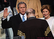 WASHINGTON, D.C. - Chief Justice William Rehnquist administers the presidential oath of office to George W. Bush as First Lady Laura Bush watches.  Inauguration ceremonies for the second term of President George W. Bush at the U.S. Capitol, along the National Mall and along Pennsylvania Avenue on January 19, 2005 and January 20, 2005. Photography ©DONNA FISHER/The Morning Call