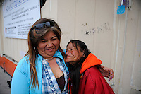 """Rita Acosta, left, comforts Lucy Soto, known as """"Shorty,"""" in front of her spot in a doorway on Soledad Street. Shorty is 54 years old, and has lived in Salinas since 1964. She was distraught at having lost much of what she needs to keep warm during the sweep."""