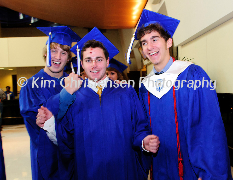 Andrew Wallace, left Brent Walker and Alec Walker give a small cheer before the Friendswood High School Graduation held at Moody Gardens.