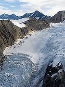 Aerial view of a glacier and the Alaska Range on a sightseeing flight from Talkeetna, Alaska.