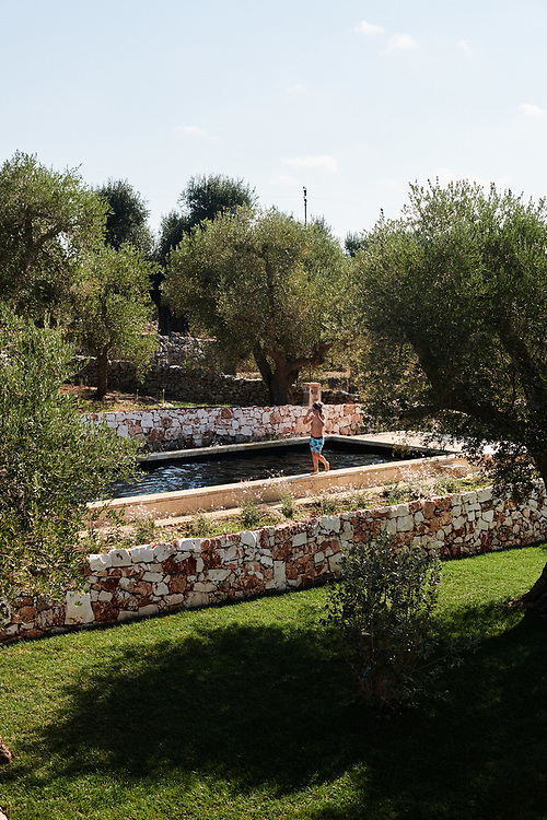 Collette Dinnigan's son Hunter going for a swim at their villa in Puglia. Ostuni, Italia. September 28, 2019.