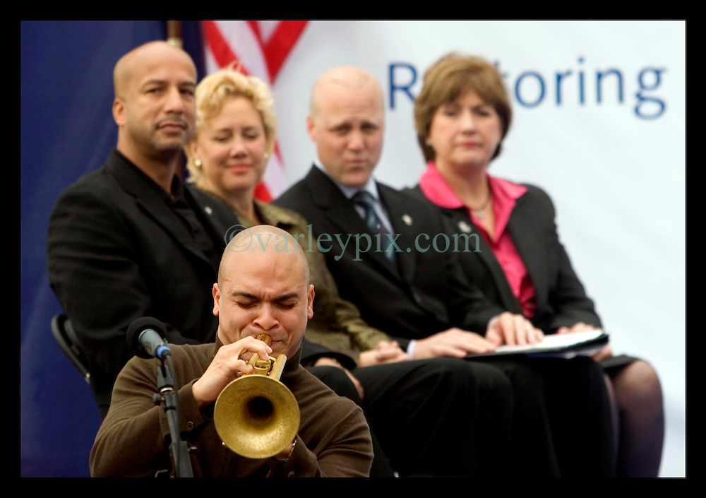 1st January, 2006. New Year's Day in New Orleans, Louisiana. Louisiana Rebirth interfaith service at the Superdome rings out the old disasterous 2005 and rings in what politicians and locals hope will be a successful 2006. Legendary Jazz trumpeter Irvin Mayfield plays a touching tribute to his late father as politicians (from left) Mayor Ray Nagin, US Senator Mary Landrieu, Lieutenant Govenor Mitch Landrieu and Governor Kathleen Blanco look on.