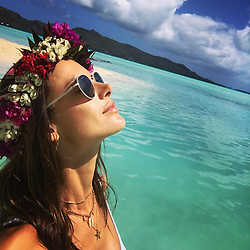 """Alessandra Ambrosio releases a photo on Instagram with the following caption: """"I'm just a dreamer , but you are just a dream .... \ud83d\udcab\ud83d\udc96\ud83d\udca6\u2600\ufe0f\ud83c\udf34 #BoraBora #foreveronvacation #heavenonearth"""". Photo Credit: Instagram *** No USA Distribution *** For Editorial Use Only *** Not to be Published in Books or Photo Books ***  Please note: Fees charged by the agency are for the agency's services only, and do not, nor are they intended to, convey to the user any ownership of Copyright or License in the material. The agency does not claim any ownership including but not limited to Copyright or License in the attached material. By publishing this material you expressly agree to indemnify and to hold the agency and its directors, shareholders and employees harmless from any loss, claims, damages, demands, expenses (including legal fees), or any causes of action or allegation against the agency arising out of or connected in any way with publication of the material."""