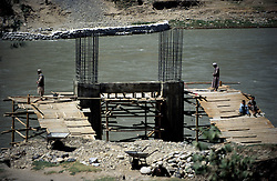 FAIZABAD, 27 July 2005..KOKCHA RIVER....A new bridge is under construction, ..Muslims are performing 'Salat'