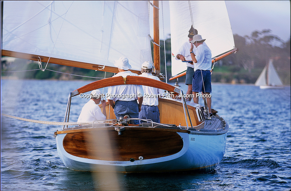 A classic timber hulled gaff rigged boat under sail  on the Swan River.
