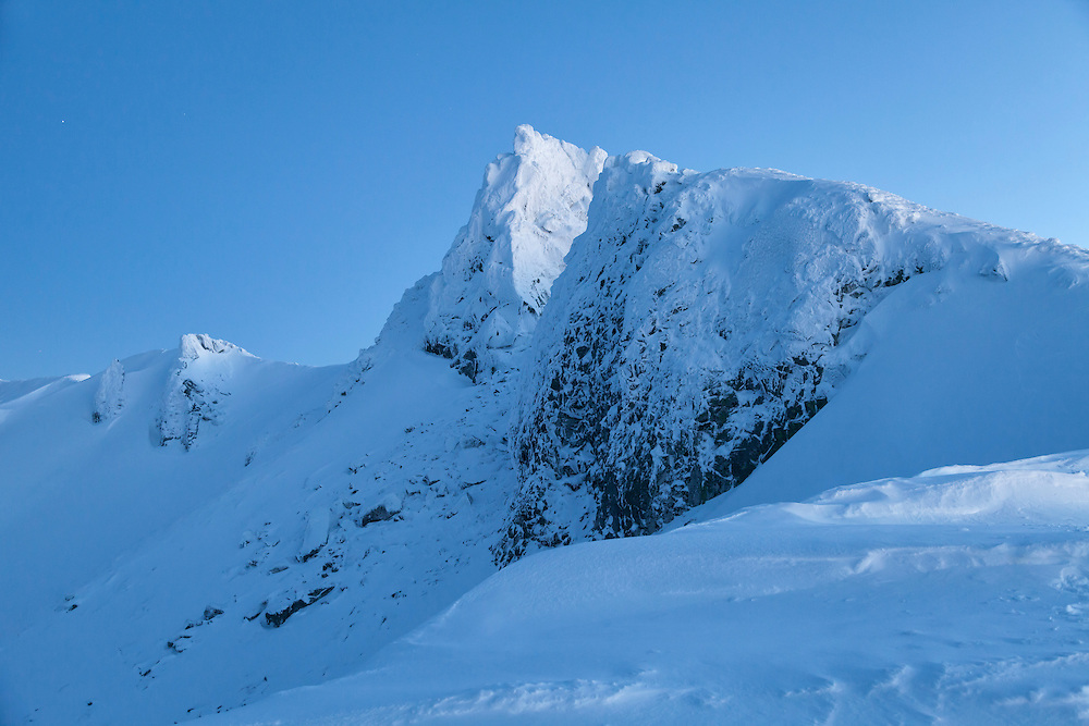 Puy de Redon in evening blue light covered with snow