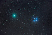 In December of 2018 Comet 46P/Wirtanen flew by the Pleiades in the constellation Taurus. Also known as the Seven Sisters, this star cluster is one of the closest to Earth at a distance of about 444 light years away. The extra hot and luminous stars cast their light on the nearby reflection nebula, which gives it the blue color. Comet 46P/Wirtanen was at it's closest approach just 7.2 million miles (11.5 million km) away from Earth. This makes it one of the top 10 closest comet encounters of the Space Age. While they look the same size in this image, the comet is quite a bit fainter, just barely detectable to the naked eye. The nucleus of the comet is less than 1 mile wide, but it's diffuse coma (cometary atmosphere) is larger than the planet Jupiter.