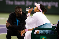 March 9, 2019 - Indian Wells, USA - Jermaine Jenkins coaches Naomi Osaka during her second-round match at the 2019 BNP Paribas Open WTA Premier Mandatory tennis tournament (Credit Image: © AFP7 via ZUMA Wire)