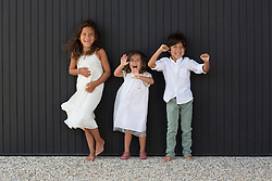 three very happy children laughing and smiling