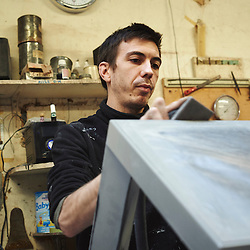 Paris, France. Atelier Midavaine. December 12, 2014. At the Atelier Midavaine, Sylvain is in charge of coating the wood surfaces. Photo: Antoine Doyen for The Wall Street Journal - GURU