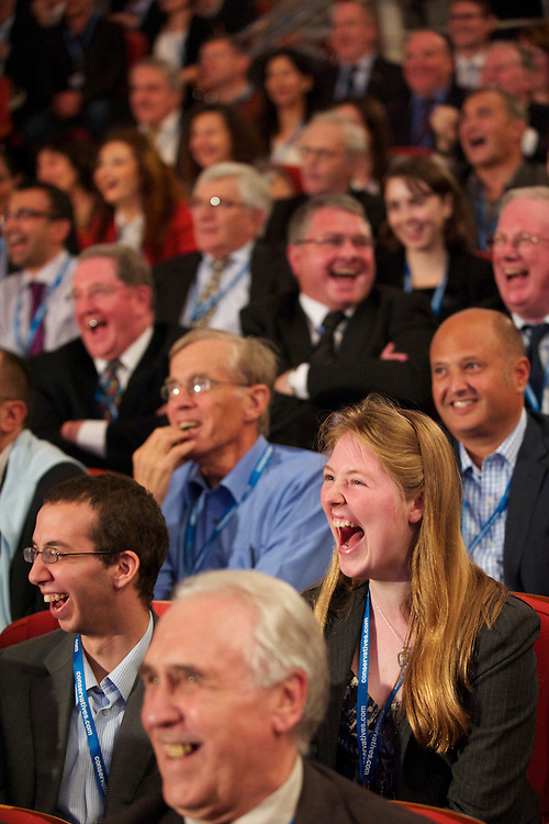The audience erupts in laughter during Prime Minister David Cameron leader's speech on the fourth, and final, day of the Conservatives Party Conference at the ICC, Birmingham, England on October 6, 2010.  Mr. Cameron delineated the controversial spending cuts which have drawn much ire of the public and fellow MPs alike.