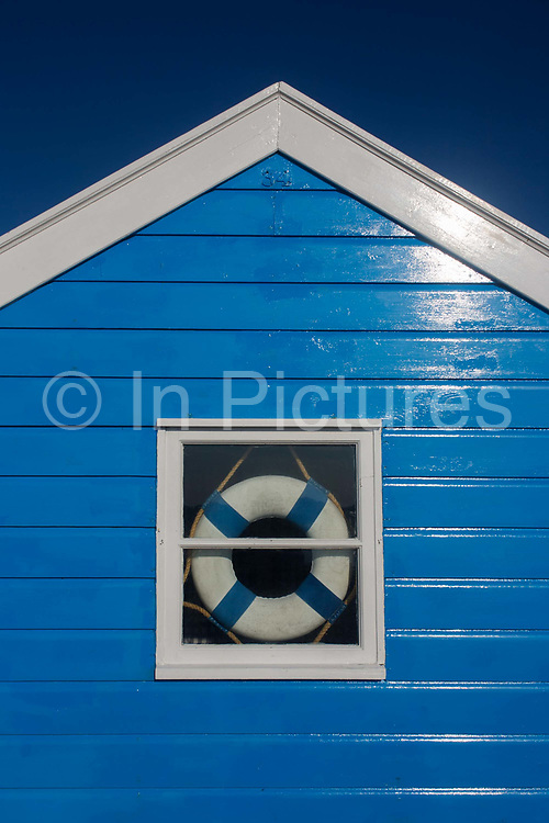 Expensive real estate beach hut at the Suffolk seaside town of Southwold, Suffolk, known for its lack of branded commercialism. A beach hut (also known as a beach cabin or bathing box) is a small, usually wooden and often brightly coloured, box. The huts are an iconic image resorts such as Southwold, the most quintessential of British beach holiday destinations. Today Southwold's beach huts are most likely to hit the national media because of their value meaning that they sell for large sums of money. Estate agents Durrants say huts on the promenade behind the sale item can go for £100,000. In 2012 a derelict beach hut in Southwold was on the market for £40,000.