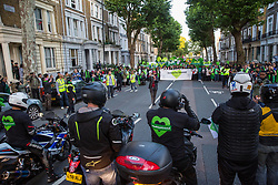 London, UK. 14 June, 2019. Motorcycle riders from UnitedRide4Grenfell greet members of the Grenfell community taking part in the Grenfell Silent Walk around North Kensington on the second anniversary of the Grenfell Tower fire on 14th June 2017 in which 72 people died and over 70 were injured.