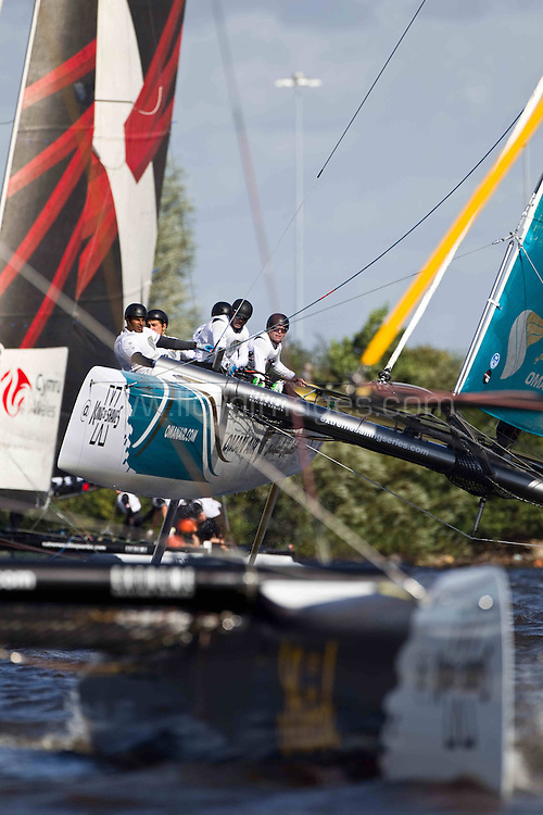 30th August, 2012..Act 5, Cardiff, Extreme Sailing Series. Day 01. Images showing Oman Air, skippered by Morgan Larson (USA), with tactician Will Howden (GBR), mainsail trimmer Charlie Ogletree (USA), headsail trimmer Andy Maloney (NZL) and bowman Nasser Al Mashari (OMA). .Cardiff, Wales. ..Credit: Lloyd Images